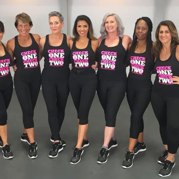 women lined up in breast cancer awareness workout gear